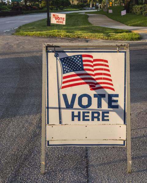 """Weston, Fl – November 3, 2020: """"Vote here"""" sign during election day at Weston polling location. Credit: Andres Guerrero"""