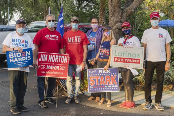 Weston, Fl – November 3, 2020: A group portrait of Weston residents campaining during election day at Weston polling location. Credit: Andres Guerrero