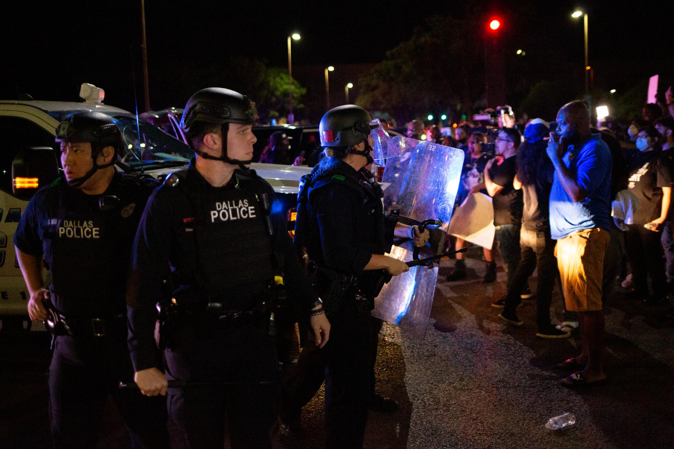 """Police reacted to the march of protestors with body shields and """"non-lethal"""" weapons. Protestors start to deface Police Property in response."""