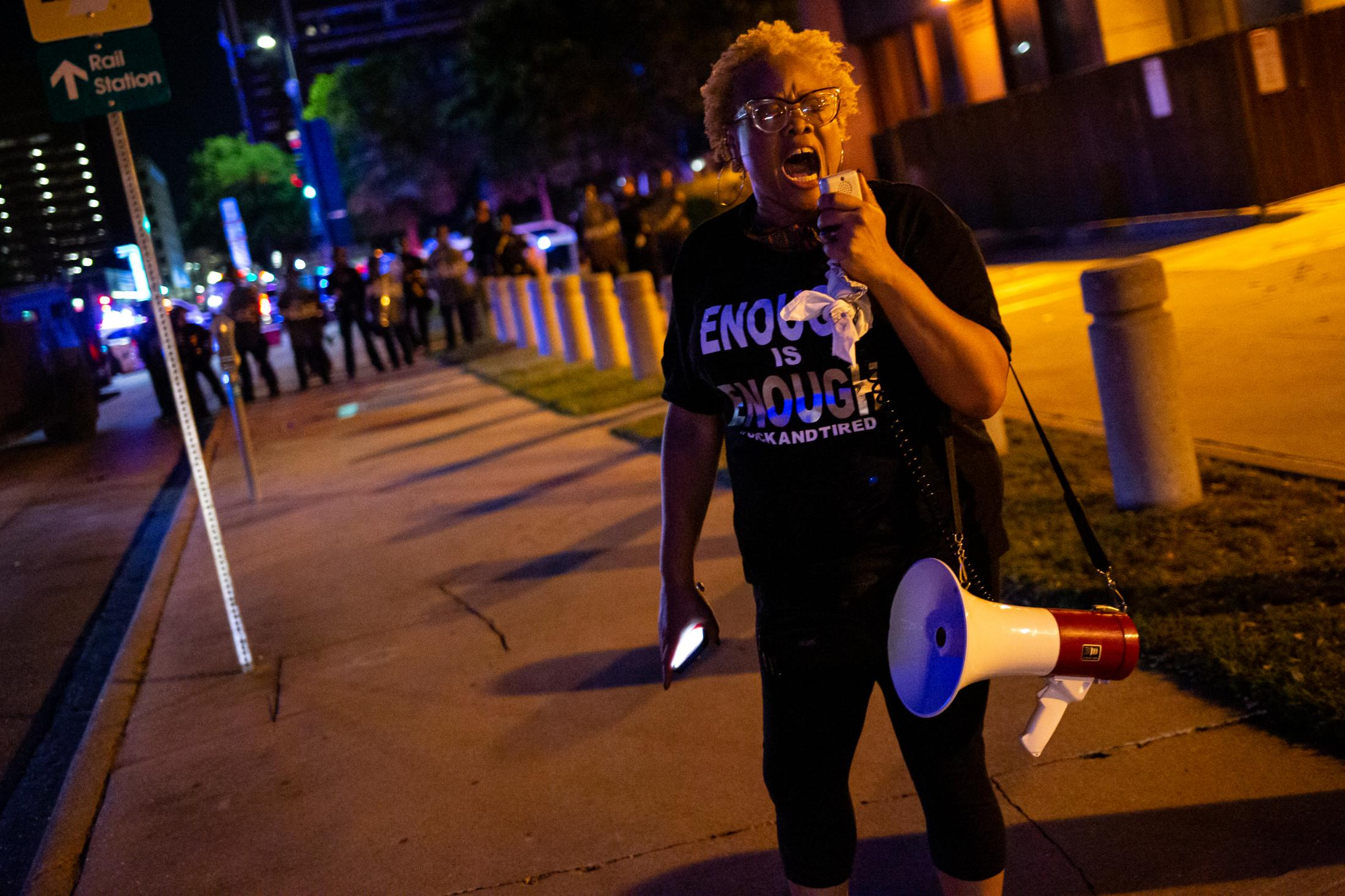 A lone woman screams into a bull horn protesting in response to a video that went viral of a man named George Floyd being killed in public by Minneapolis Police.
