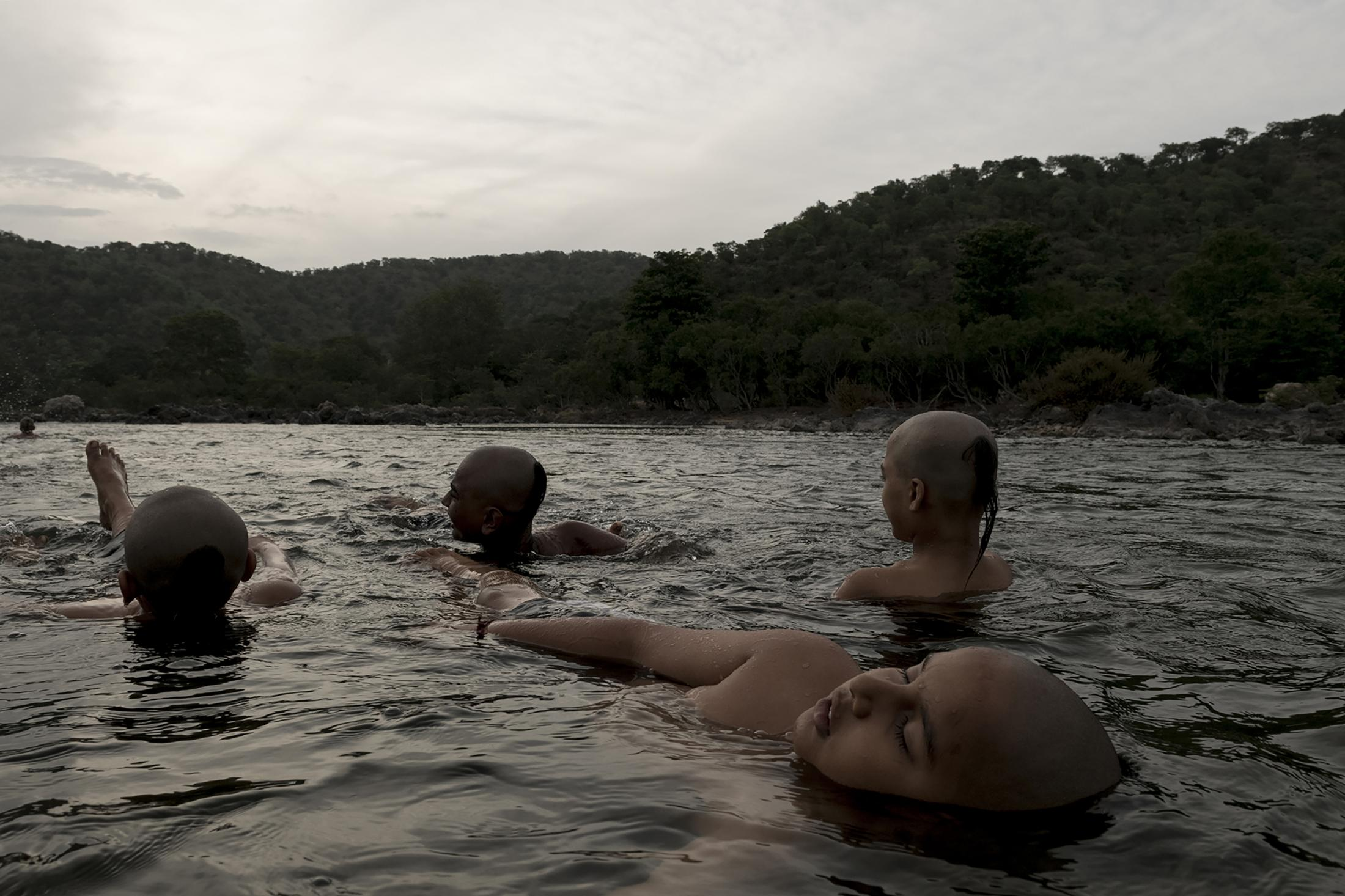 Students take river bathe during Brahma muhurta. This is an auspicious period of 48 minutes that begins 1 hour 36 minutes before sunrise and ends 48 minutes before the sunrise. Central channel of life energy in our body remains active during this time. This is the best time for meditation as well.