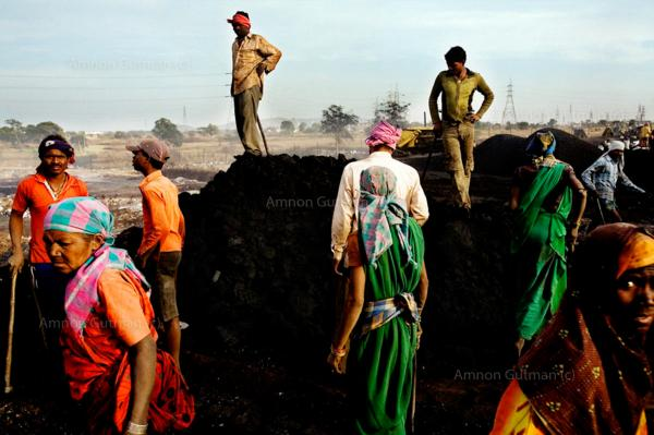 Villagers from Kalmi, gathering iron from the debris of a steel plant which inhabits their village. Chhatisgrah.