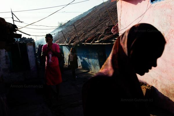 Daily life at the village of Golakdyh, which borders an area where underground coal is burning, Jahariah, Jjarkhand, India.
