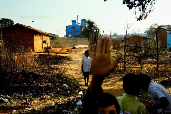 School children playing at their school, which very near the main sponge plant, at the village of Tamnar, Chhatisgrah.