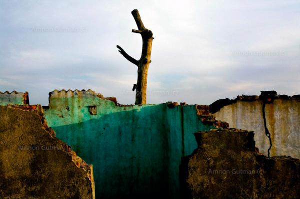 The remains of village houses, at Kumar Baste, a village that borders an area where underground coal is burning, Jarkahnd, India.