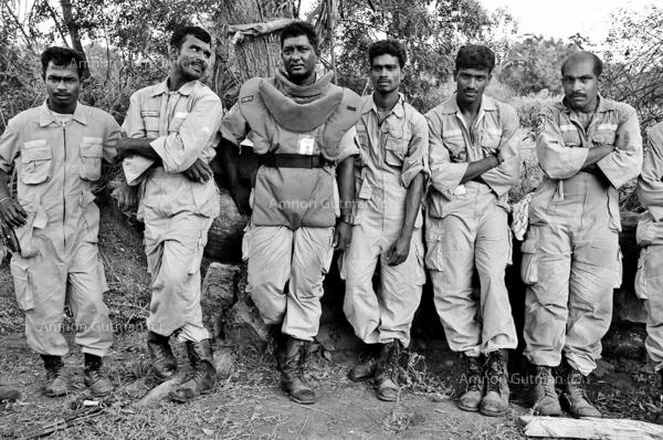 D-miners taking a break while clearing a former SLA camp from mines. Vavunia town, North Sri Lanka.