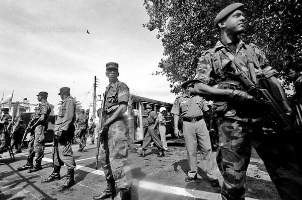SLA (Sri Lanka army) soldiers guarding the site of a bus bombing, 4 people were killed and 20 injured, the attack, allegedly happened by the LTTE, in the capital Colombo.