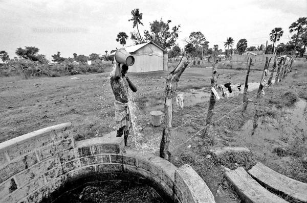Tamil man washes himself at Vakari village which was taken by the SLA from LTTE, East Sri Lanka.