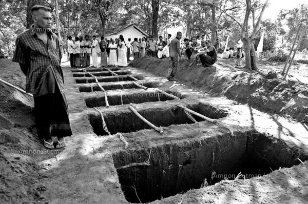 Graves ready for the burial of Sinhalese civilians , who were killed by a roadside claymore mine made allegedly by LTTE carders. 26 people were killed and 63 injured in the attack. Buttala, South Sri Lanka.