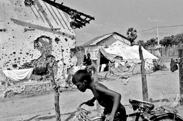 Tamil people at their destroyed home, which was taken by the SLA, East Sri Lanka.
