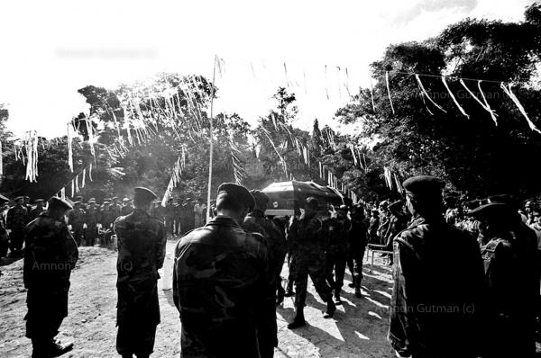 A funeral procession of an SLA soldier, who was killed by a claymore mine explosion on the bus he was traveling in, made allegedly by LTTE cardes. Buttala. South Sri Lanka. 26 civilians kiiled and 63 injured in the bombing.