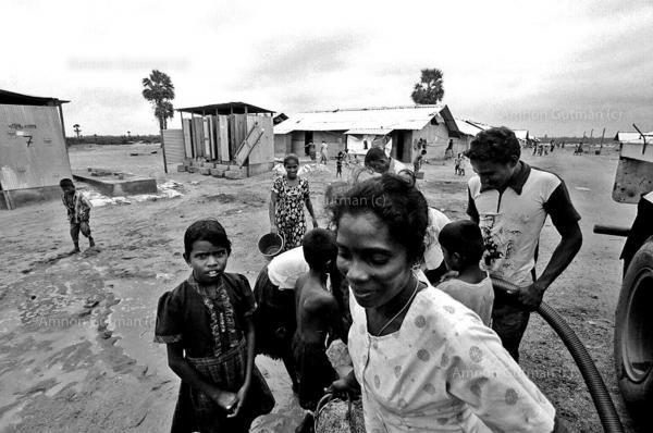 Tamil people collecting water at the IDP camp of Pelachalai, Batticaloa, East Sri Lanka.