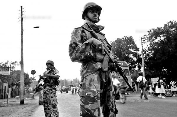 SLA soldierspatrolling the streets of Vavunia town, North Sri Lanka.