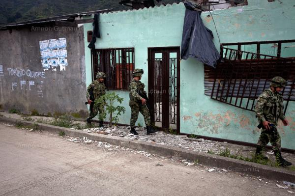 Colombian army soldiers patrol the streets of Toribio, North Cauca.