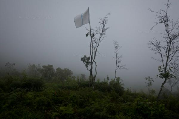 A white flag, marking the border between the area controlled by the Nasa and the Colombian army, on Mt Berlin, a disputed area. Toribio, North Caucain during July 2012 Indigenous activists stormed the hill top military base (on Mt Berlin) in protest over land rights.