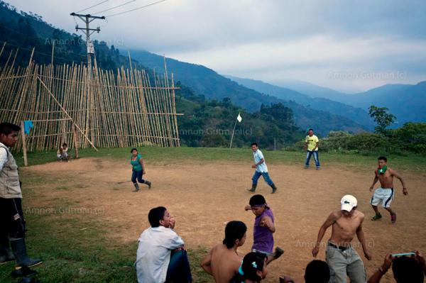 Members of the Nasa guard playing soccer, on a hilltop patch of land which was controlled by the Colombian army ... the people pushed the army out of their posts ion order. to pacifay the area from the ongoing conflict, as there is a large Nasa communitynear by, Miranda, North Cauca.