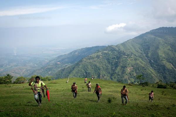 Members of the Nasa guard climbing Mt Dantas, in order to patrol disputed areas where the Colombian army is stationed in. Miranda, North Cauca.