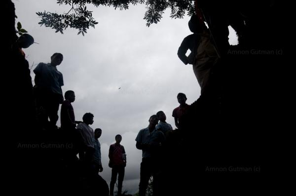 Nasa people stand infant of an illegal mine , which the local leadership decided to shutdown, Canoas, North Cauca.