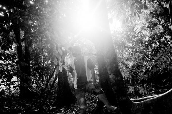 Nardo Bayugan stands beside the graves of his ancestralelders , Duma Logdog village, Mindanao.