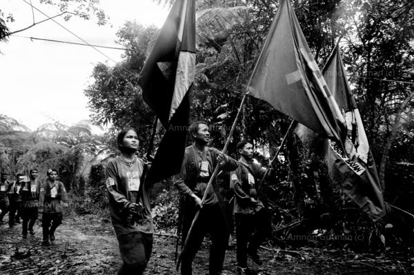 NPAsoldiers celebrating the organisation 40 yearsanniversary, at a hideout in thejungle, Mindanao.