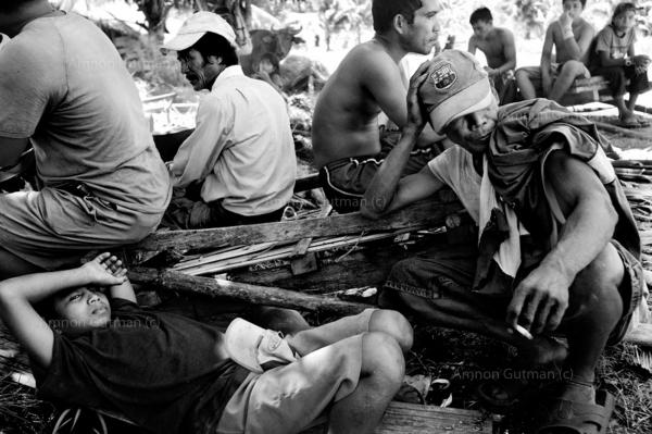 Taking a break during a long day of working in the fields, at the no mans land between christian and muslim communities.