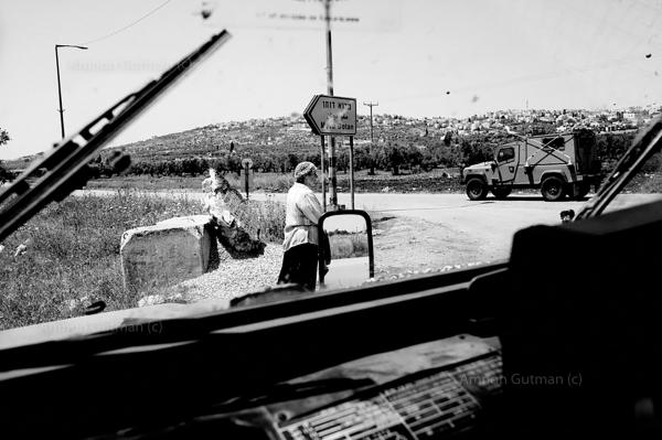 Reservists guarding a settlers march between two settlements, near Jenin.
