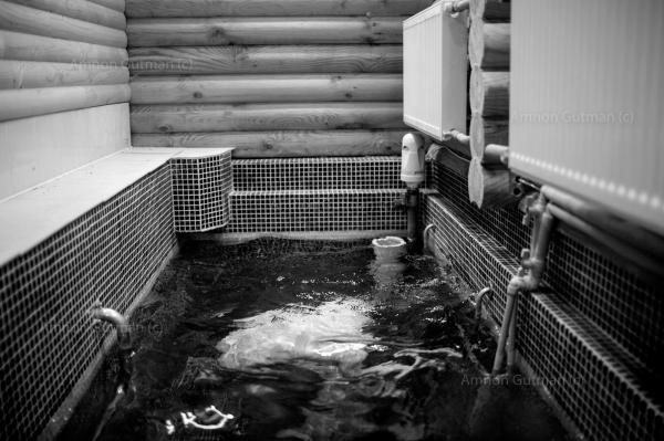 Shneor (31) who lives with his wife and two children in the village, washing himself in Anatevka synagogue Mikveh, before his morning pray. Mikveh is a bath used for the purpose of ritual immersion in Judaism to achieve ritual purity. Shneor came from Israel with his family in 2016 to live in Kiev, and in 2018 moved to be a teacher in Anatevka.