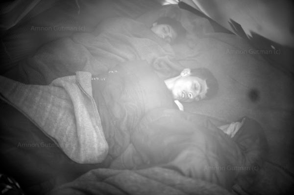 Syrian refugees sleep in their tent at Idomeni camp.