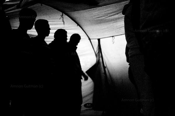 Syrian refugeespray in a tent that was customisedas a place of worship, near the tents they live in, in the camp.