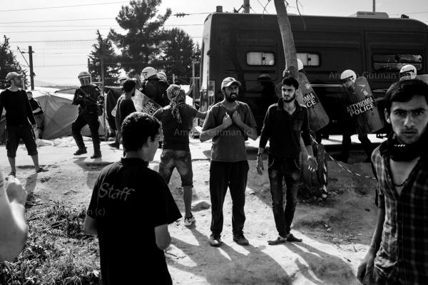 Greek riot police deploying in Idomeni camp, after a refugee died in an accident, prompting tensions between the refugees in the camp and the police.