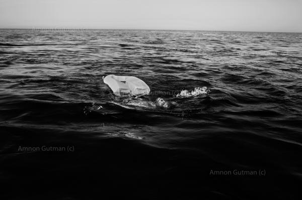A refuge from Africa trying to stay afloat after falling from the rubber boat he was on. seconds later he was rescued by Sea Watch crew members.