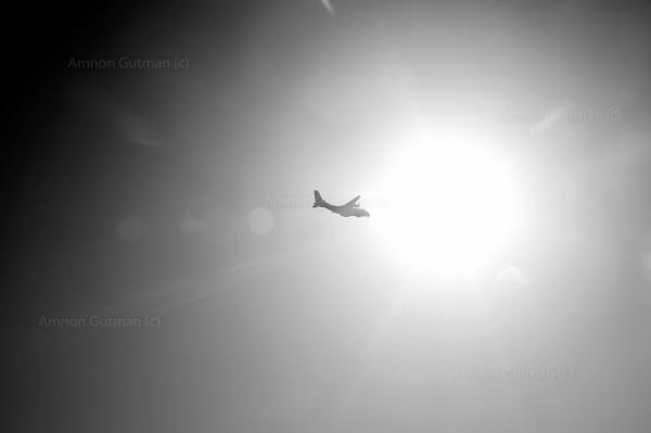 An Italian coast guard air plane, patrolling over the 24 miles zone, in the Mediterranean sea, looking for refuges boats.