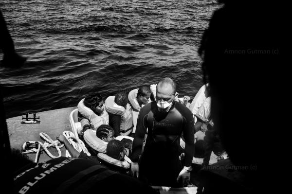 An Italian navy officer waiting to pick up more refuges from Sea Watch 2, on his speed boat, in order to transfer them to a bigger Italian navy ship, that will take the refuges to Italy.