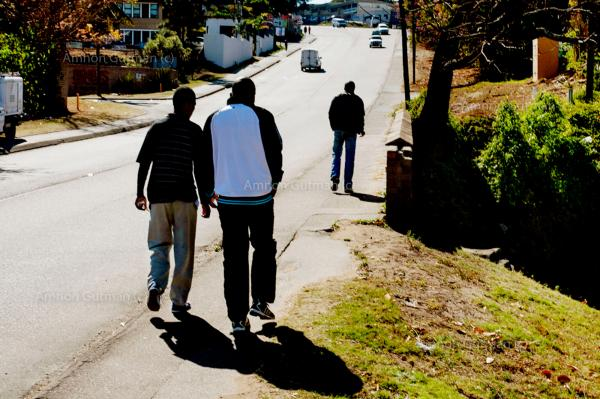 Young adults who went through the circumcision procedure earlier in the day, walking back home.