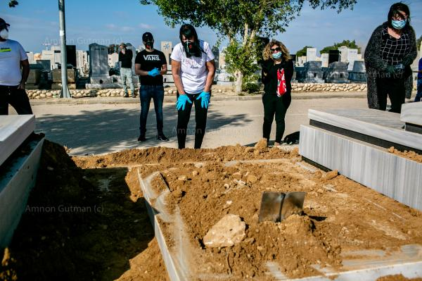 Family members of Yaffa Nagar (age 90) mourning during her funeral. she passed away from Covid-19. Beer-Sheva cemetery, Israel.
