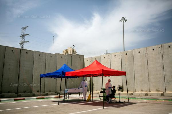 A Covid-19 testing station , at the entrance of Shuafat, in East Jerusalem neigberhood, whose residents are Palestinians, who are alsoIsraeli civilians with an official Israeli ID cards.