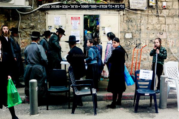 Orthodox Jews waiting outside a shop in Mea Sheraim neighbourhood. during the second month of the pandemic. parts of the orthodox communities in Israel, decided not to follow the lockdown rules, as they didn't believe in the existence of Covid-19.