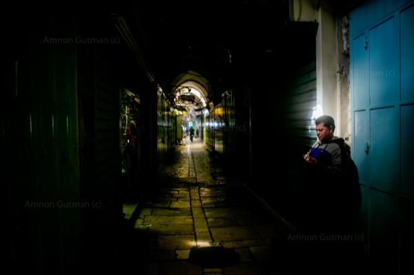 A Palestinian shop owner, waiting outside his shop, during the first lockdown, old city of Jerusalem.