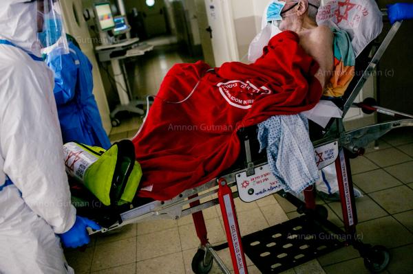 A Covid-19 patient being carried in by paramedics to the Covid-19 emergency unit in Ichilov hospital. Tel-Aviv.