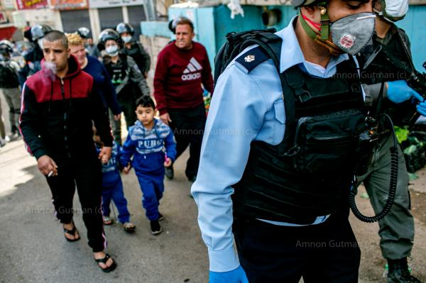 Israeli police officers during a patrol in the Palestinian refugee camp of Shuafat. East Jerusalem.