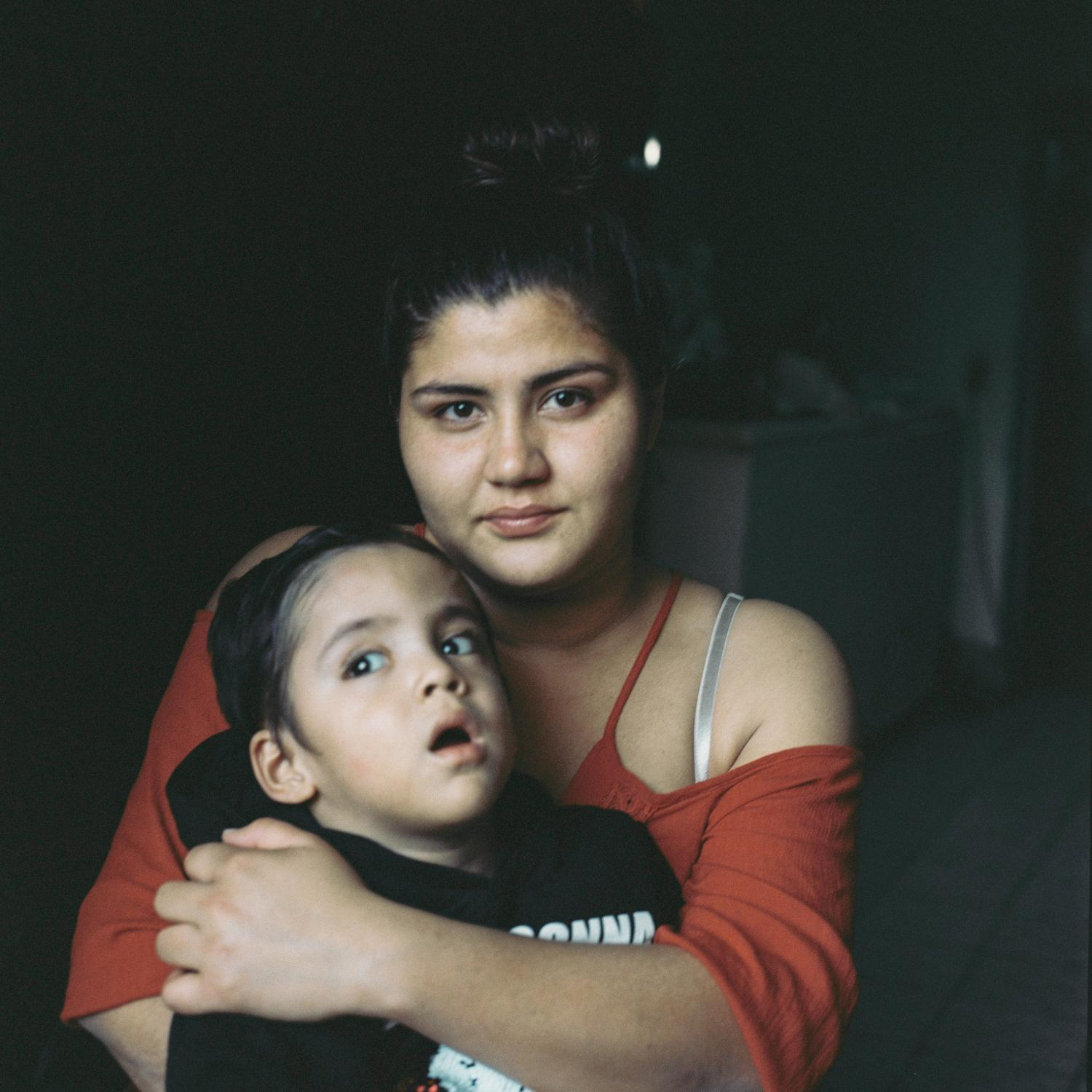 """Fabiola Guadalupe Tirado Guarcia 19 years old with her 3 year and a half year old son Jesús Tadeo Cortez Tirado. The father of Jesús is Alain the missing son of Irma. Jesus has a disability. """"I have a dad, well I had a dad who disappeared in 2013. He's been missing for 7 and I still know nothing on his fate. I got together with my son's dad and they made him disappear too. I carried in living. When my son was 2 years-old, I got in a relationship with another man and he too was disappeared. Here in Sinaloa life is a little bit hard on this side."""" Shot with the support of the CNAP. Mazatlan, Sinaloa, Mexico, March 2021."""