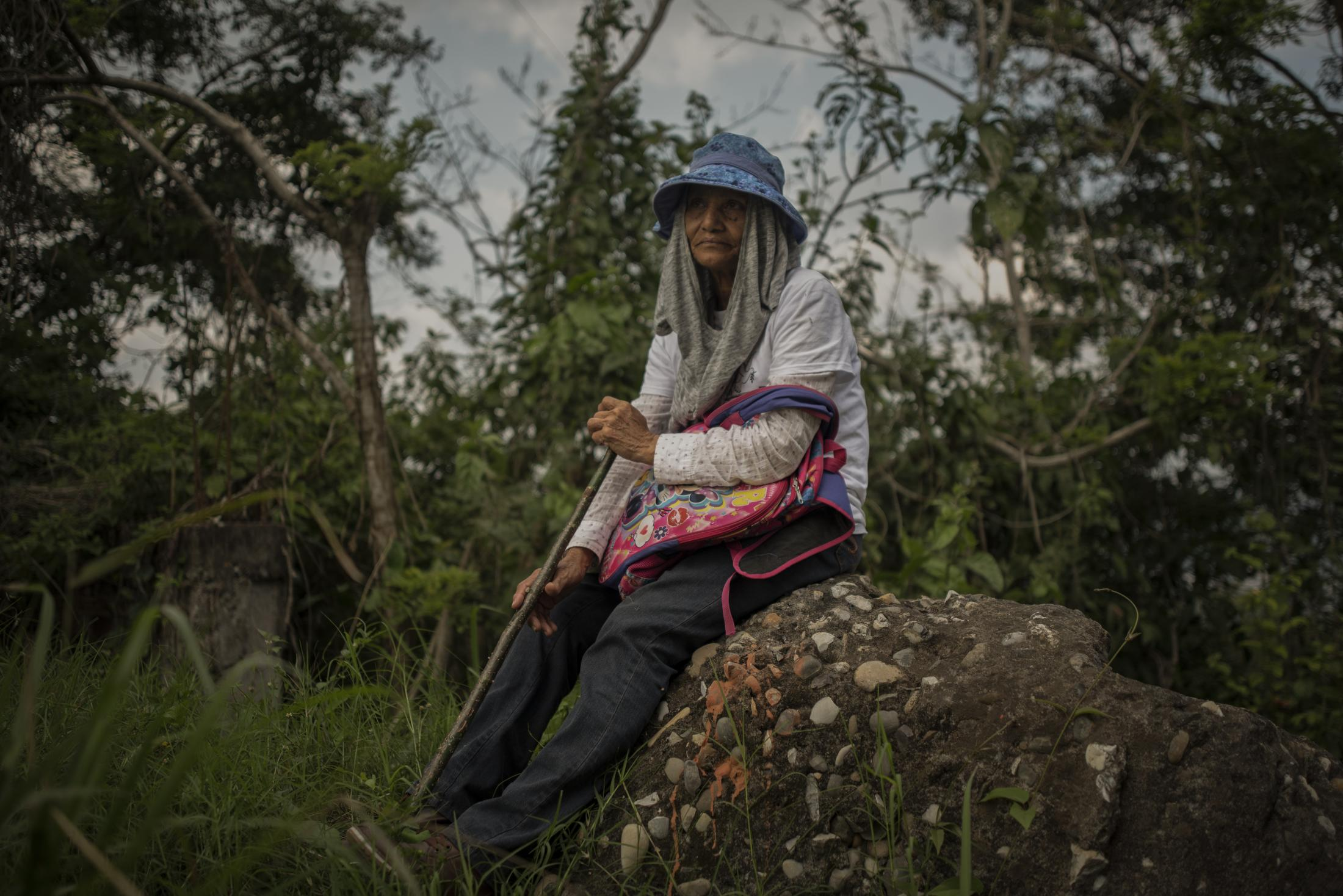 February 20, 2020. Tihuatlan, Veracruz, Mexico. Antonia Cota, 70, seeker of missing persons from Sinaloa, Mexico, rests on a piece of land that is investigated by police authorities and groups of relatives participating in the fifth National Missing Persons Search Brigade. Victoria Razo / NPR