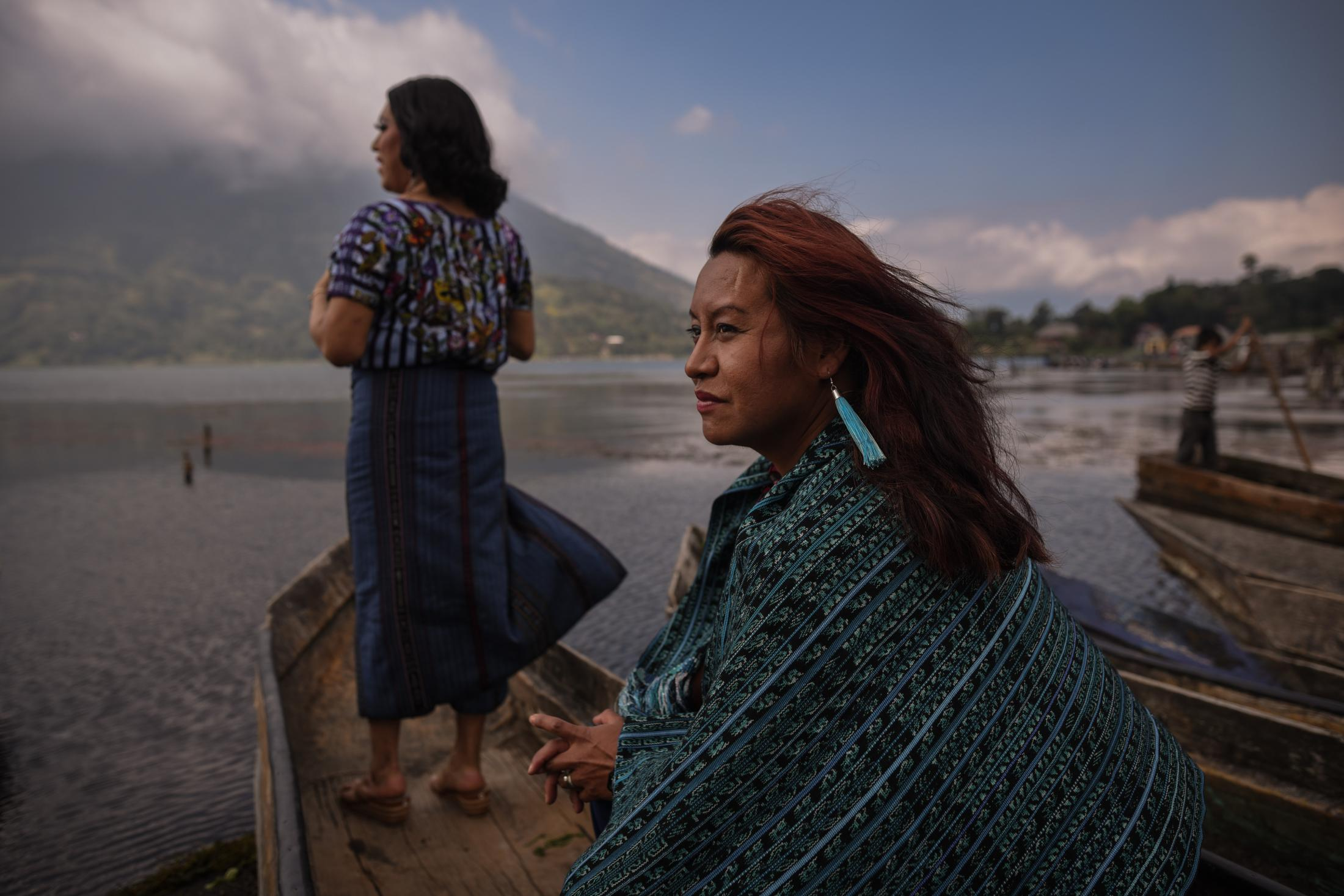 November 20, 2019. Santiago Atitlán, Guatemala. Portrait of Maria Alejandra and Kristel, two transgender women of origin Tz'utujil, observe Lake Atitlan during a sunny day. One day, while they were still little indigenous children walking through their village, China noticed a scar on the Kristel's back and asked, Kris respons her that her dad had hit her with a wire because he didn't want him to play with homosexuals.