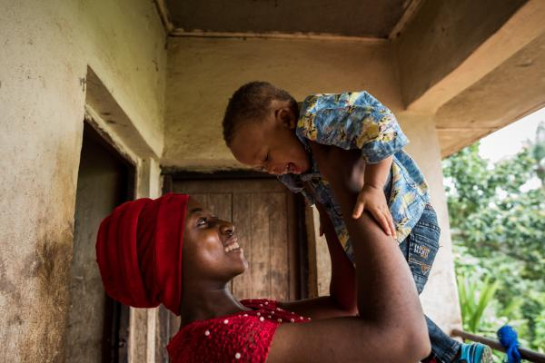 Mercy's first child, Chinaza and her younger brother, Chiagozie, share a laugh in their home in Nsukka, Enugu