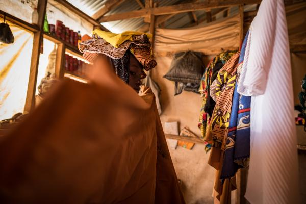 Hurairah* carries out some household chores in her home in Maiduguri.
