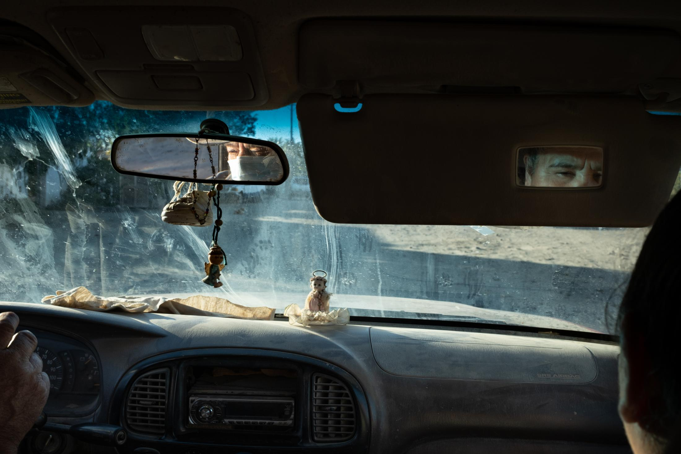 Felipe and Olga drive to buy food for their goats in San Juanico, Baja California, Mexico, January, 23rd, 2021. The land is parche at best after no rain for three years, and the goats have been having a hard time finding the wild food that grows in the desert.