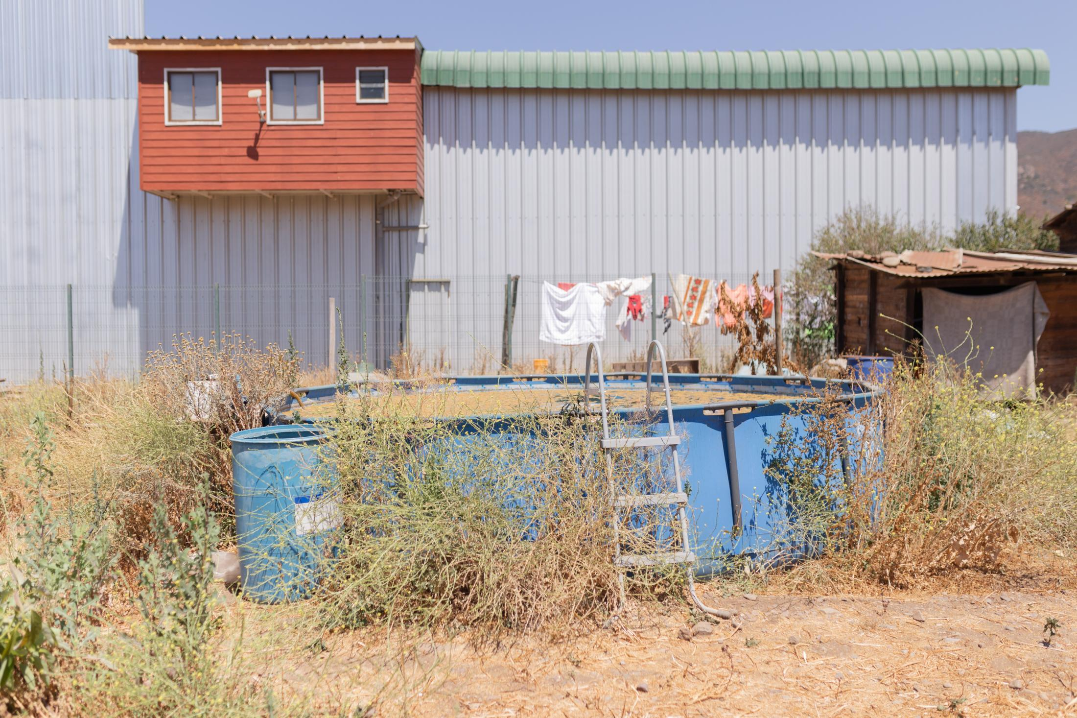 December, 21st, 2020. View of the pool with which Yasmin, resident of the community of La Higuera, Petorca Province, accumulates water. During the summer months, Yasmin can only have 3 hours of water a day for human consumption and for watering her plants. Some communities in the province have been receiving 50 liters of water a day, below the 100 liters necessary for human consumption recommended by the World Health Organisation.