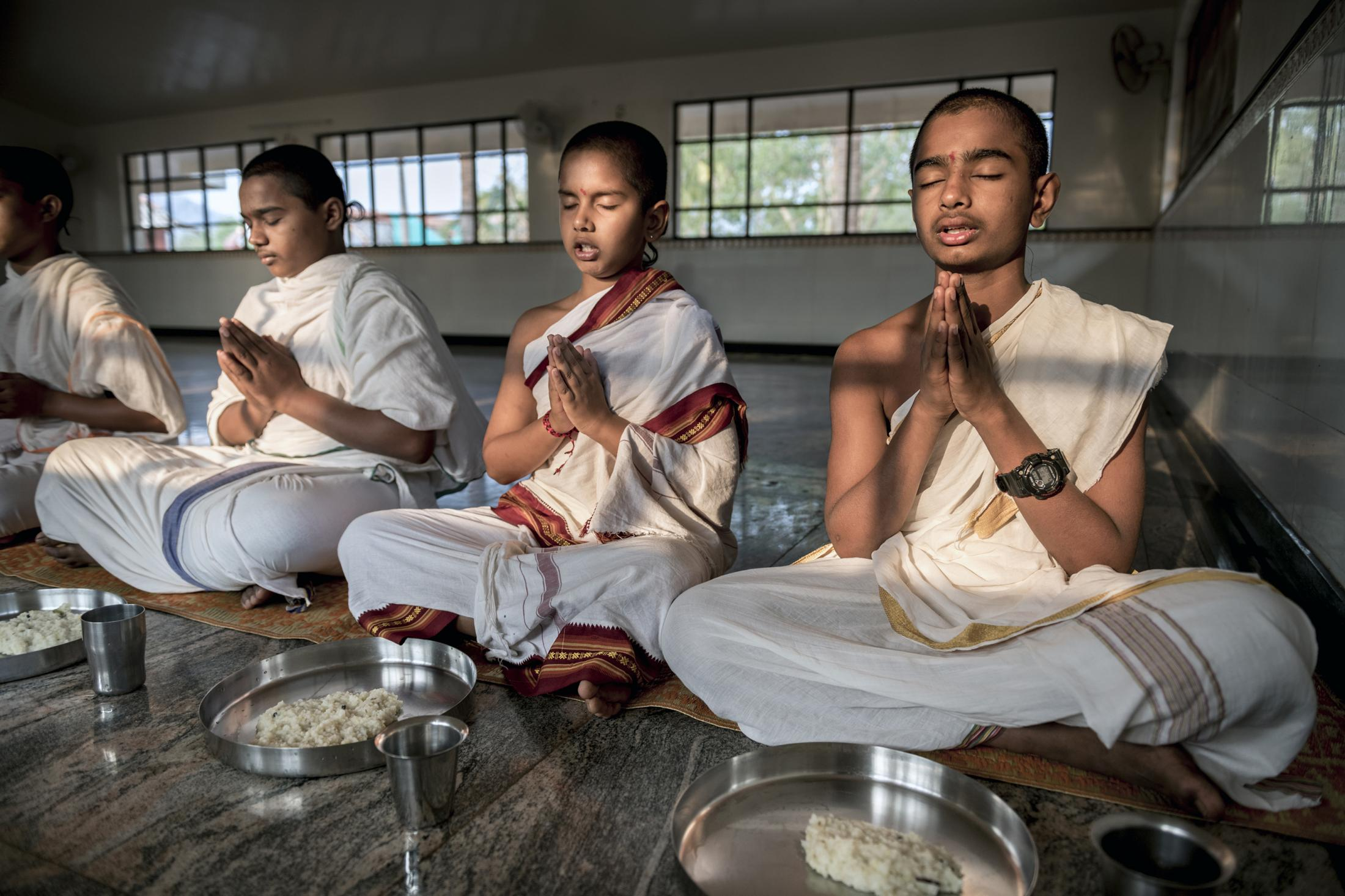 """Mealtime prayer is mandatory practice in Vedic Gurukula before every meal in a day. Gurukula provides only a Sattvic diet. The word Sattvic is derived from Sanskrit word sattva which is a complex concept in Indian philosophy, used in many contexts, and it means one that is """"pure, essence, nature, vital, energy, clean, conscious, strong, courage, true, honest, wise, rudiment of life"""". India."""
