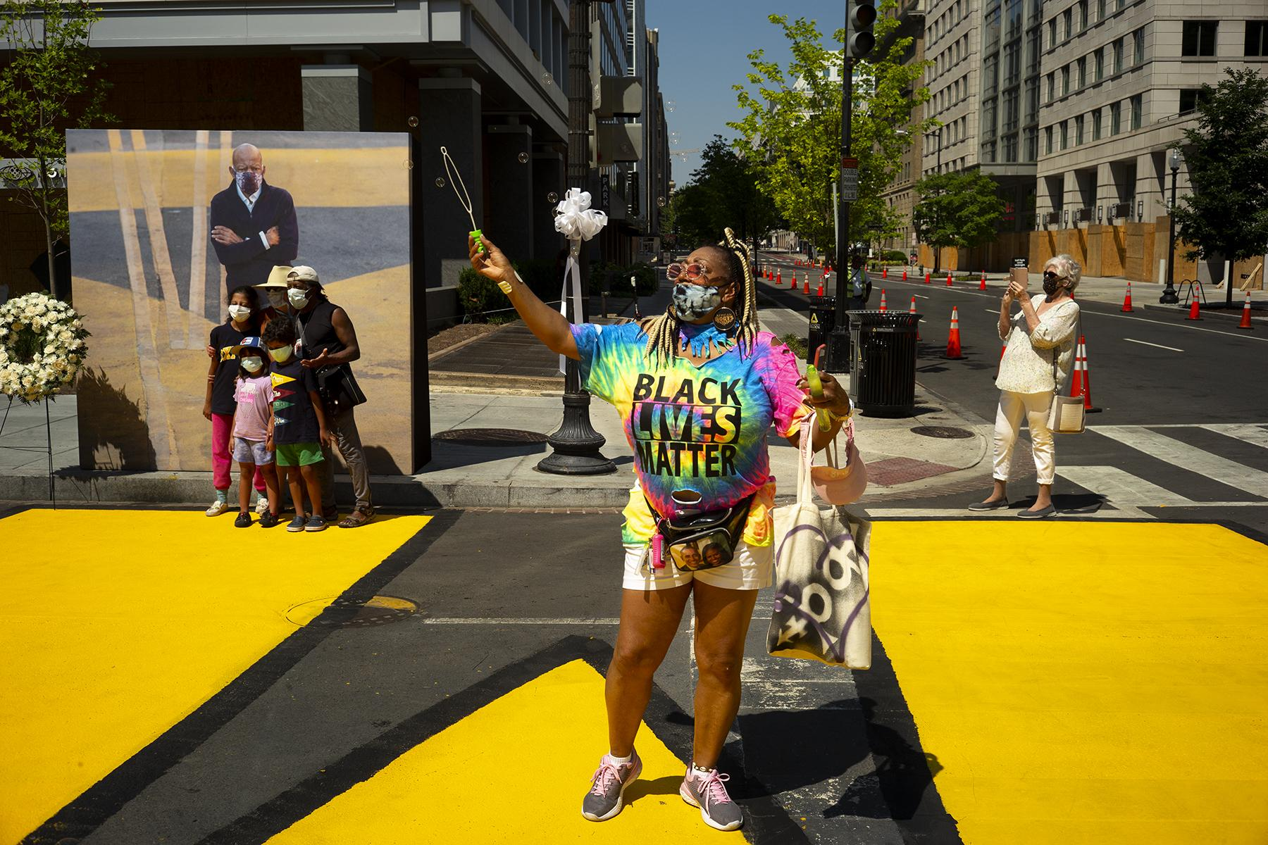 Janet Purnell came down from Philadelphia to be apart of the celebration of John Lewis at Black Lives Matter Plaza in Washington D.C. on July 27.