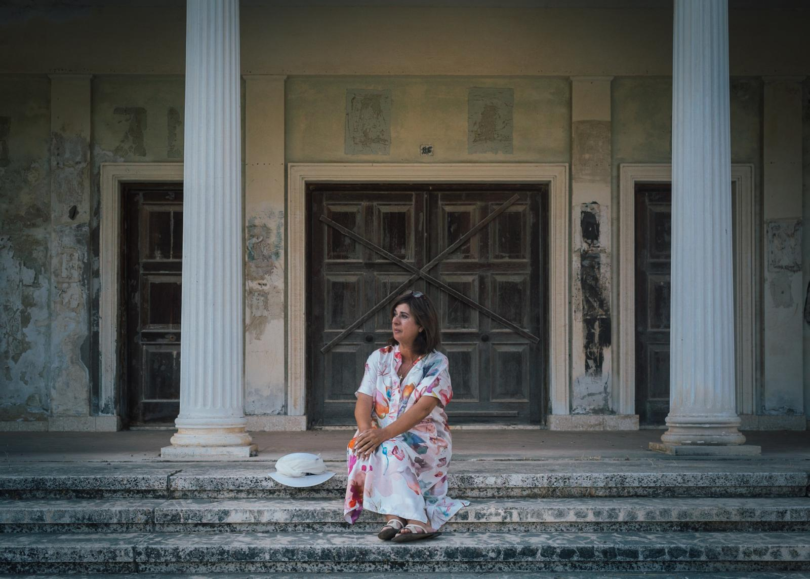 Tasoula Hadjitofi in front of her former culture school, where she learned to dance and sing.